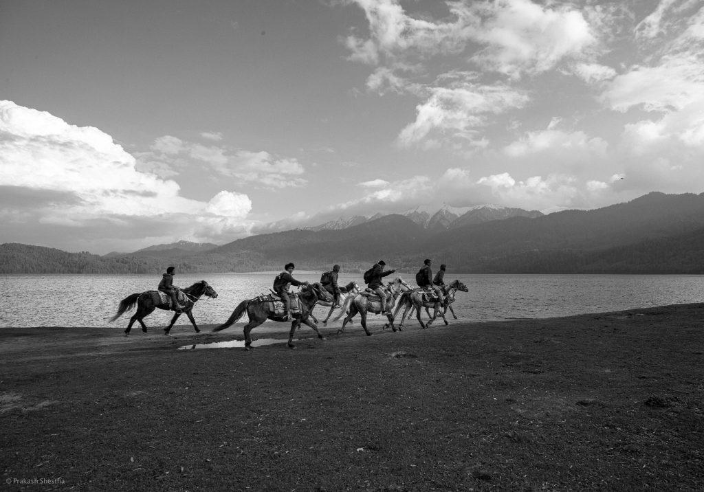 Horse riders ride their horse in Rara Lake Mugu, Nepal