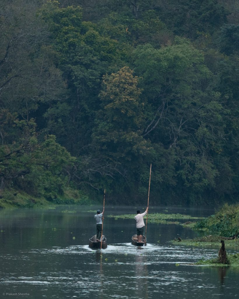 Two Boat Men floating on the river